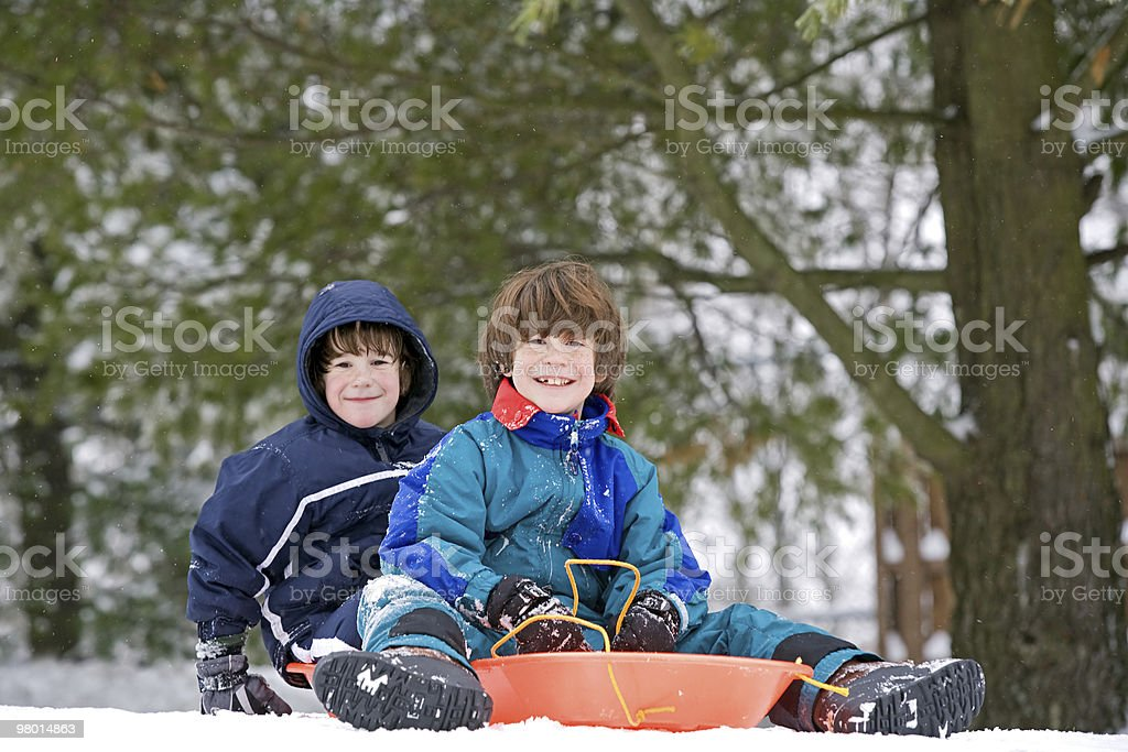 Kids Sledding royalty-free stock photo