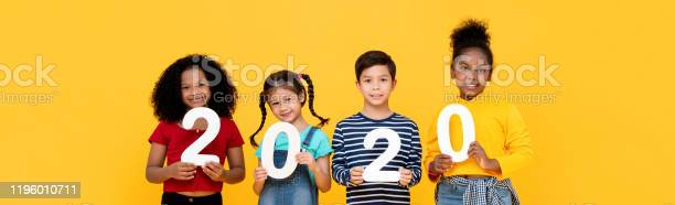 Kids smiling and holding 2020 numbers on banner background picture id1196010711?b=1&k=6&m=1196010711&s=612x612&h=jucgpji4fsxgnvfk0fk2fuajqucaqiknjzvrooqahza=