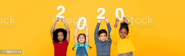 Kids smiling and holding 2020 numbers on banner background picture id1196010715?b=1&k=6&m=1196010715&s=612x612&h=o mkffofni t3falbuqbcgglfxhsl5e1tyizakxehgc=