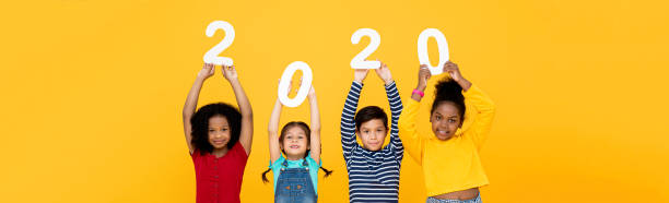 Kids smiling and holding 2020 numbers on banner background picture id1196010715?b=1&k=6&m=1196010715&s=612x612&w=0&h=munhpk7yl3efebsh5dxqbj7ugtoe5btd1spr bao1ey=