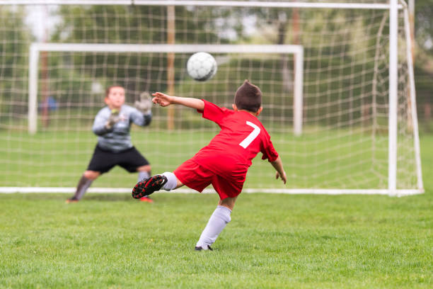 Kids soccer football - young children players match on soccer field stock photo