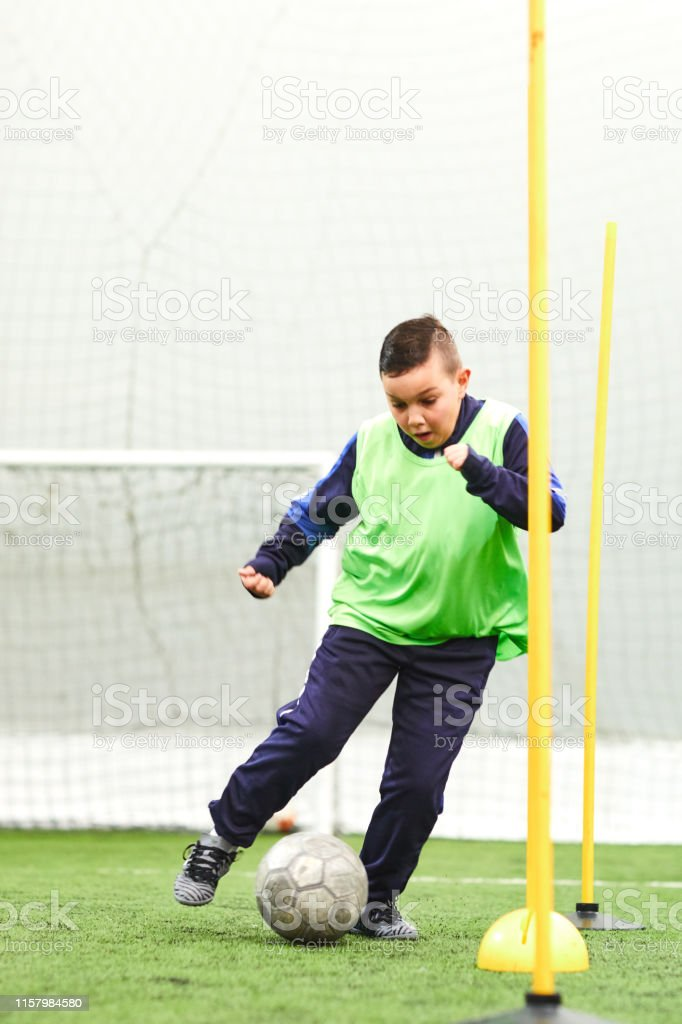Soccer player training with ball.