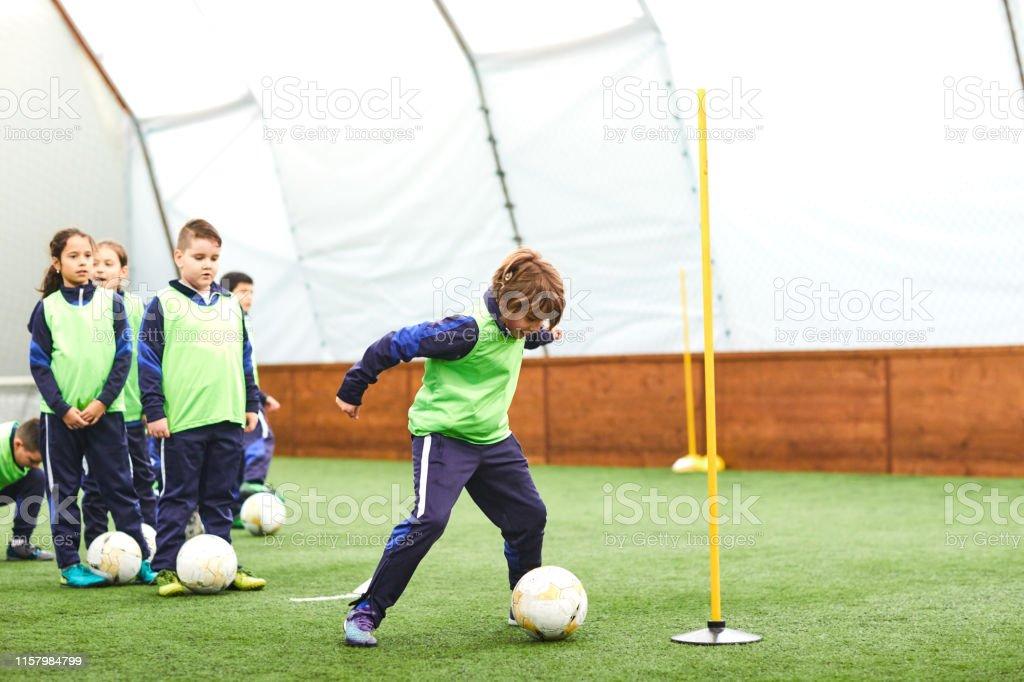 Group of children on soccer training.