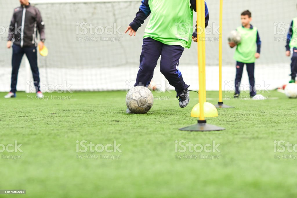 Group of children soccer players training with ball.