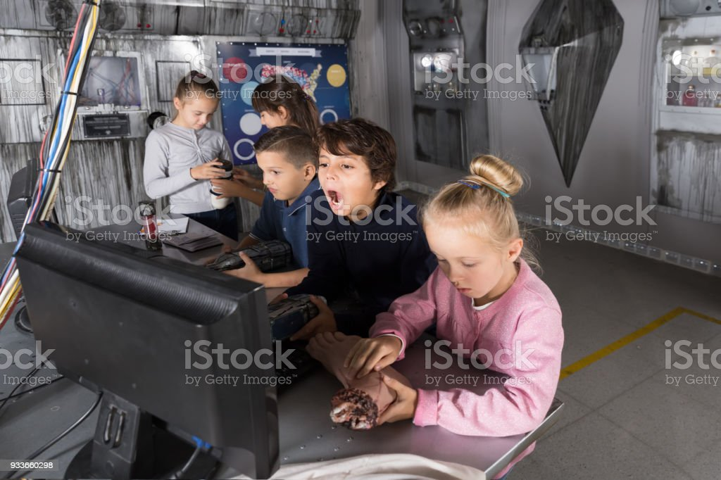 Kids  solve riddles in the quest room bunker stock photo
