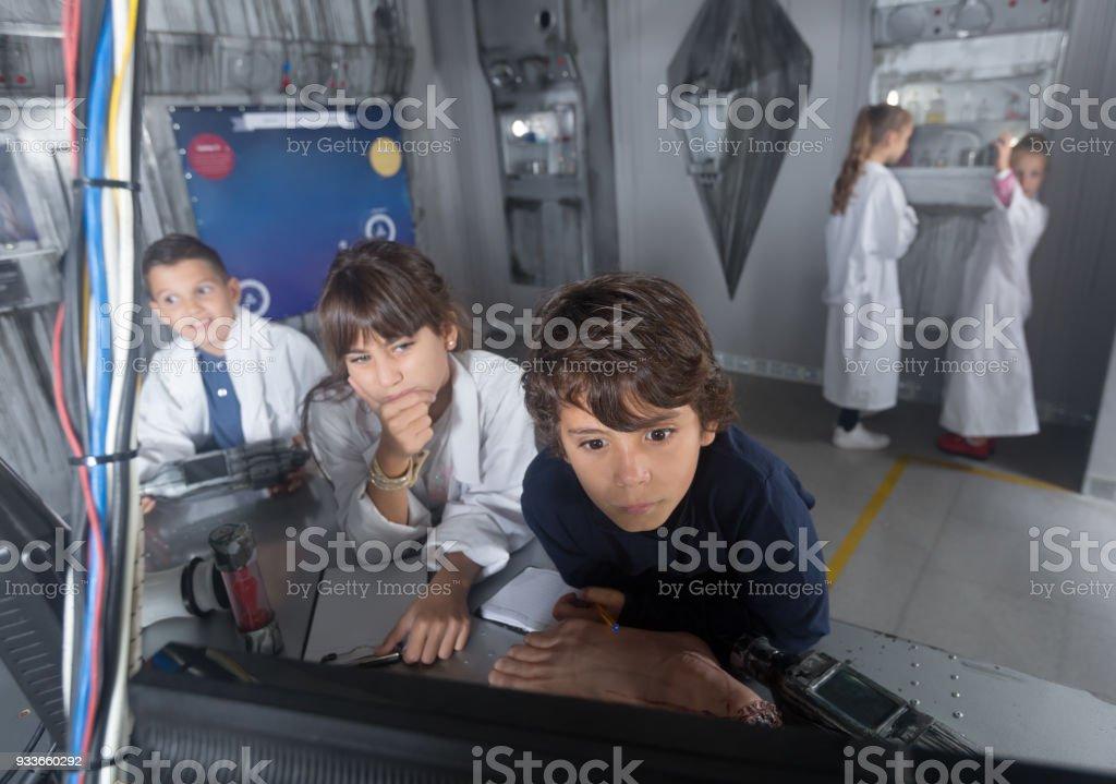 kids solve task in the bunker quest room stock photo