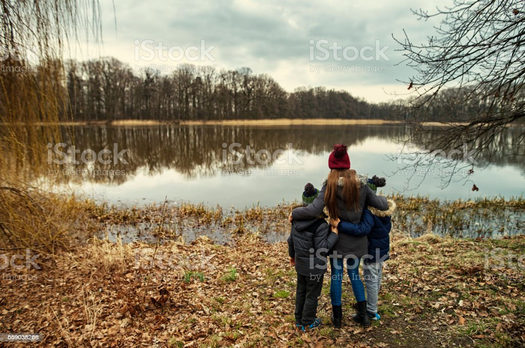 Kids standing by the lake royalty-free stock photo
