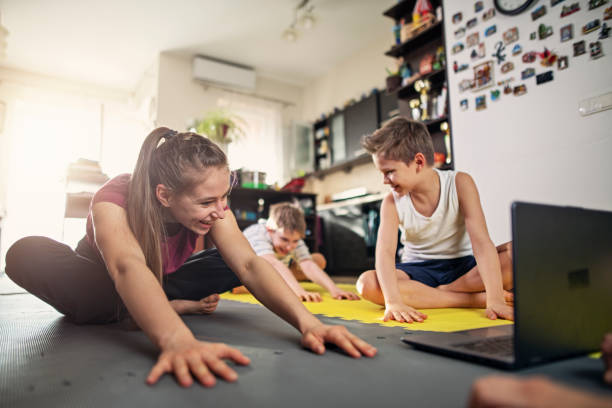 Kids stretching at home during the COVID-19 pandemic stock photo