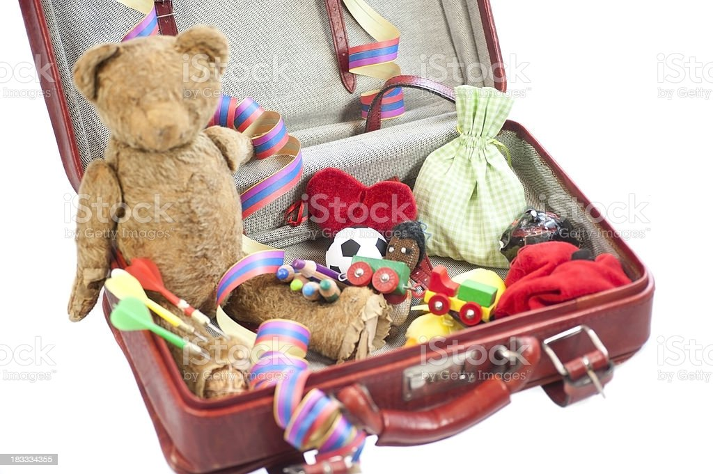 kids suitcase with toys stock photo