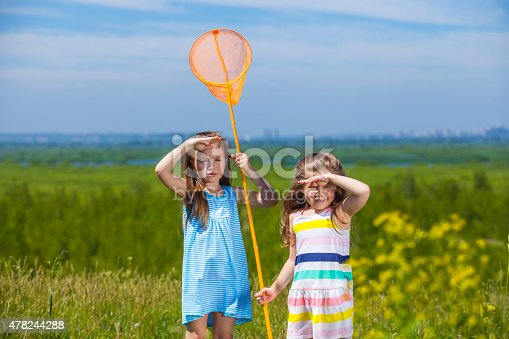 1008826222istockphoto Kids summer in the meadow with orange net 478244288
