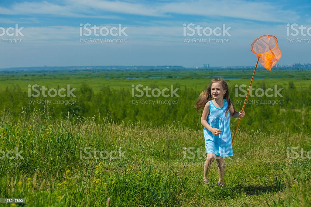 Kids summer in the meadow with orange net stock photo