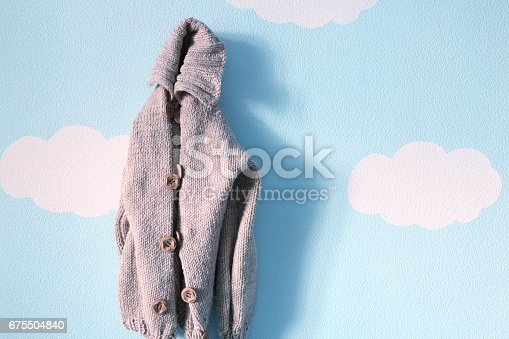 678651100 istock photo Kids sweater on the blue sky background 675504840