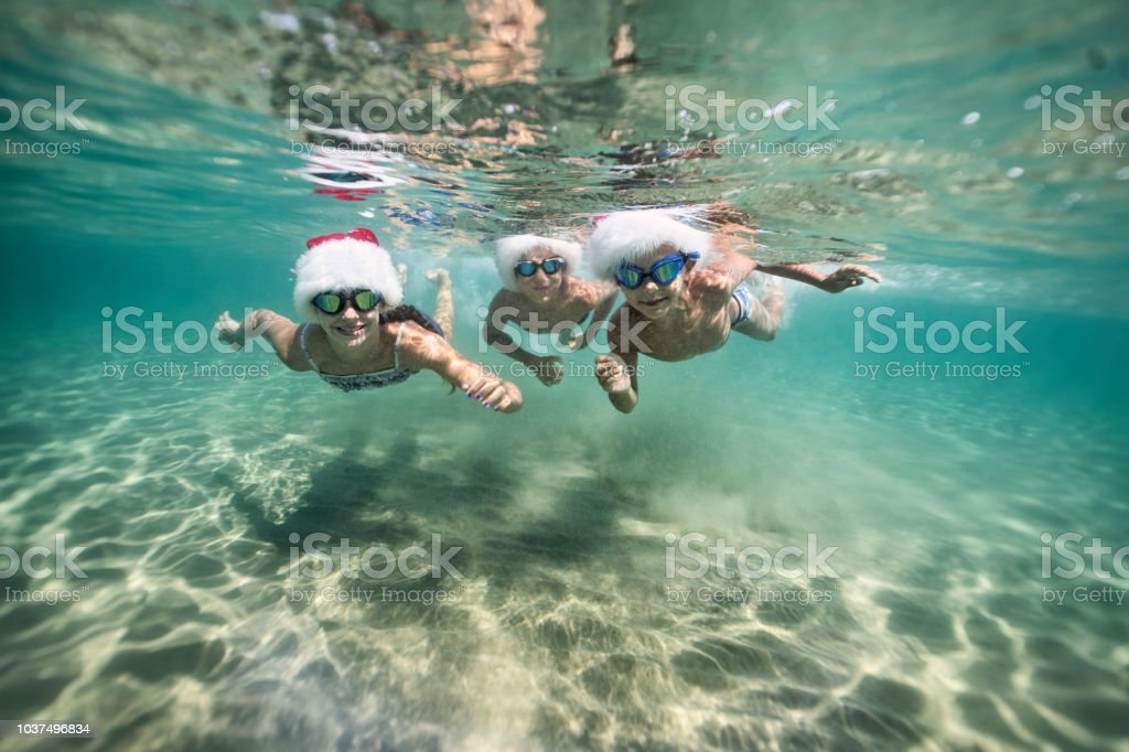Kids swimming in sea during summer Christmas royalty-free stock photo