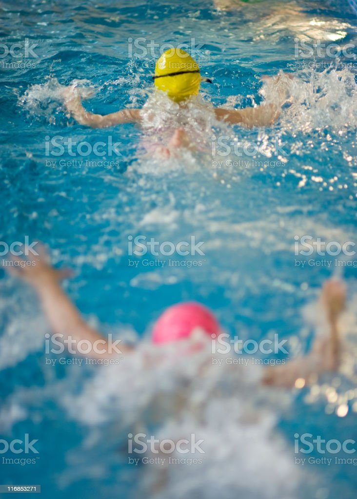 kids swimming in the pool royalty-free stock photo