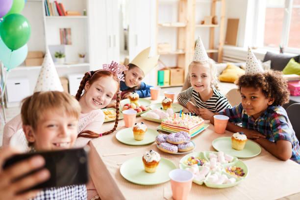 Kids Taking Selfie at Birthday Party stock photo