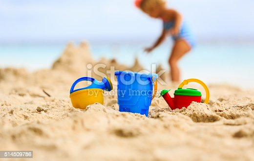 512726470 istock photo kids toys and little girl building sandcastle 514509786