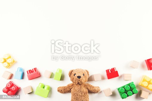 istock Kids toys background with teddy bear and colorful blocks 842862308