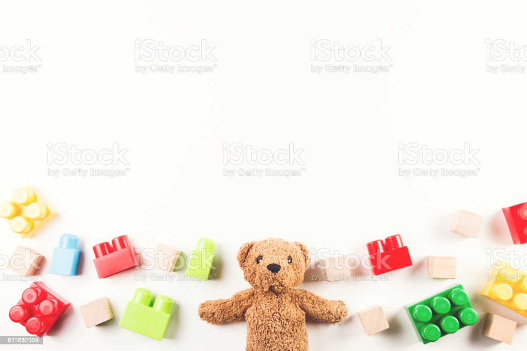 Kids toys background with teddy bear and colorful blocks stock photo