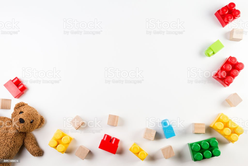 Kids toys background with teddy bear and colorful blocks royalty-free stock photo