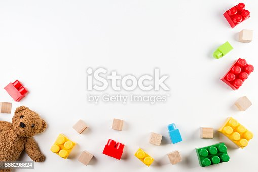 istock Kids toys background with teddy bear and colorful blocks 866298824