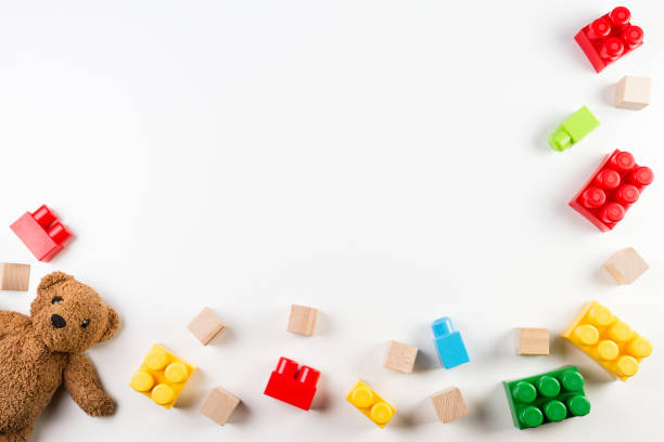 kids toys background with teddy bear and colorful blocks - toy stock pictures, royalty-free photos & images