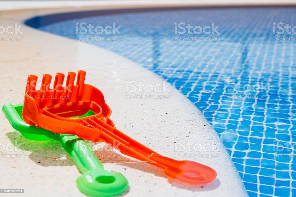 Kids toys near the pool stock photo