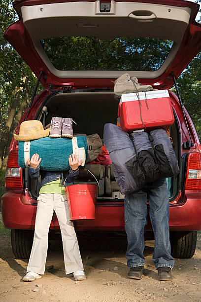 kids unpacking car - funny fat lady stock photos and pictures