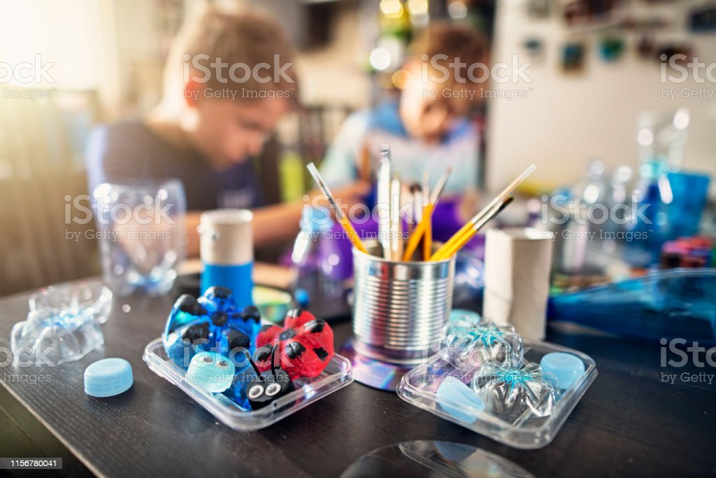 Kids upcycling - creating new fun stuff from used stuff - Royalty-free 8-9 Years Stock Photo