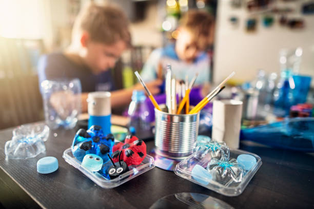 Kids upcycling - creating new fun stuff from used stuff stock photo