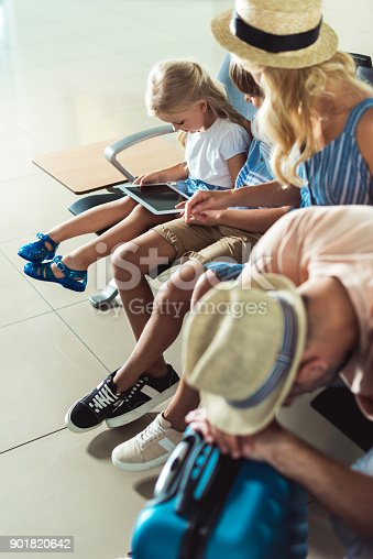 istock kids using tablet at airport 901820642