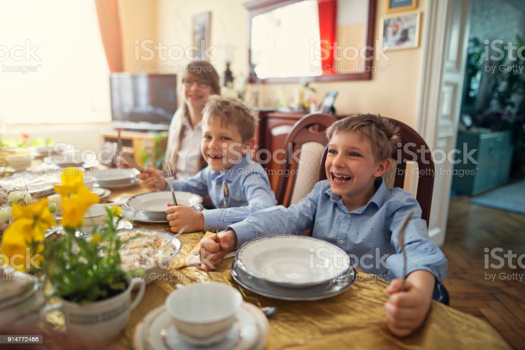 Kids waiting for traditional easter breakfast stock photo