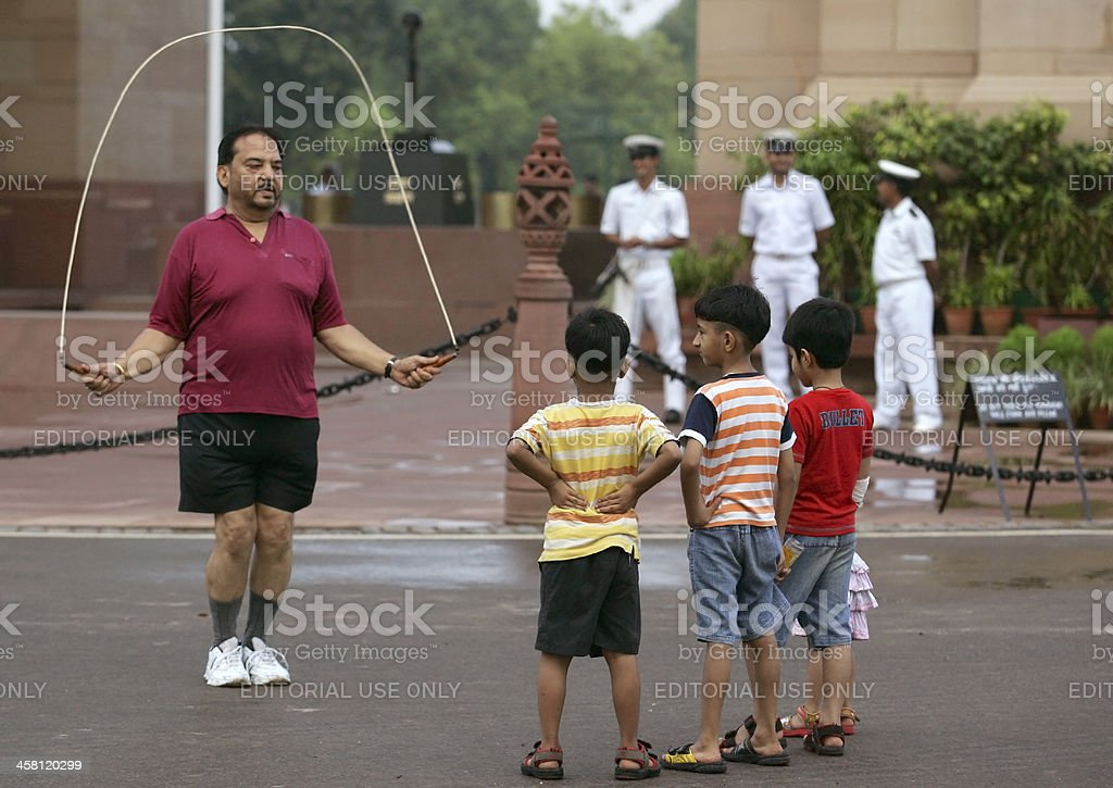 Kids watch a man work out stock photo