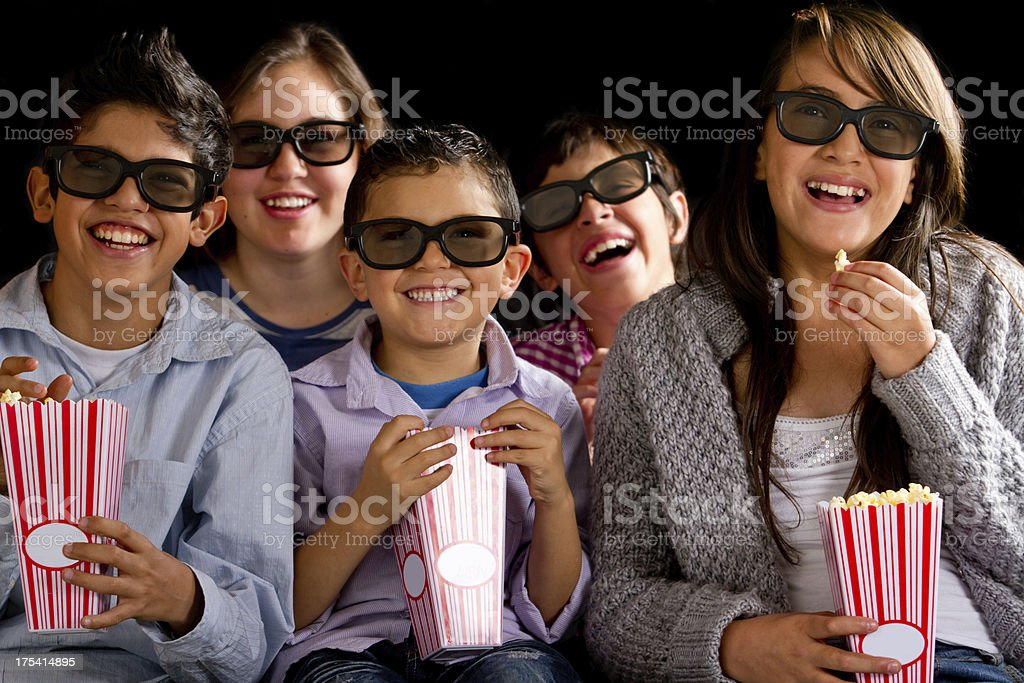 Kids watching a movie in 3D royalty-free stock photo