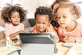 istock Kids watching video 700450638
