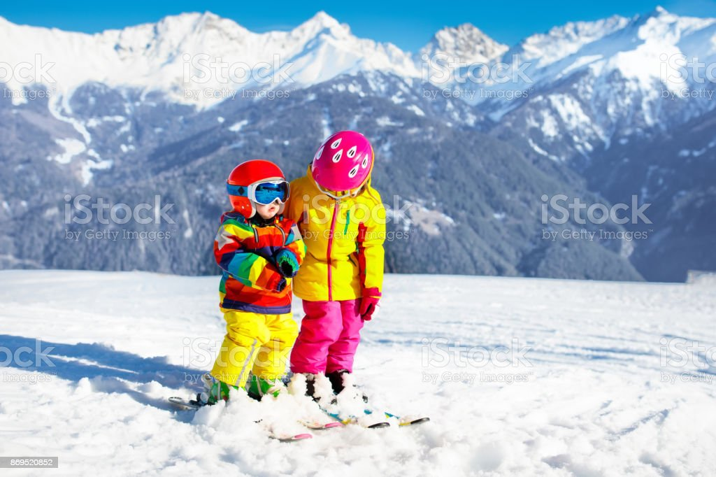 Child skiing in the mountains. Kid in ski school. Winter sport for...