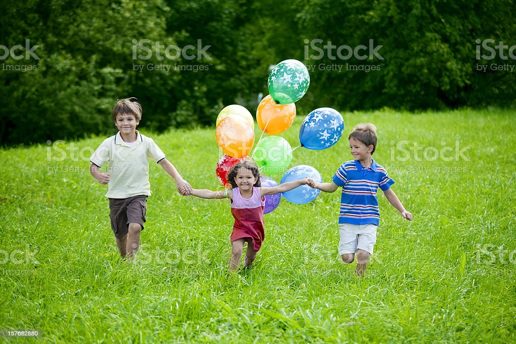 Kids with baloons royalty-free stock photo