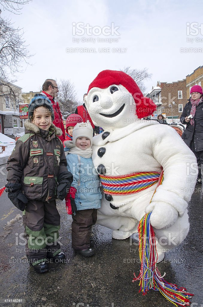 Kids with Bonhomme Carnaval stock photo