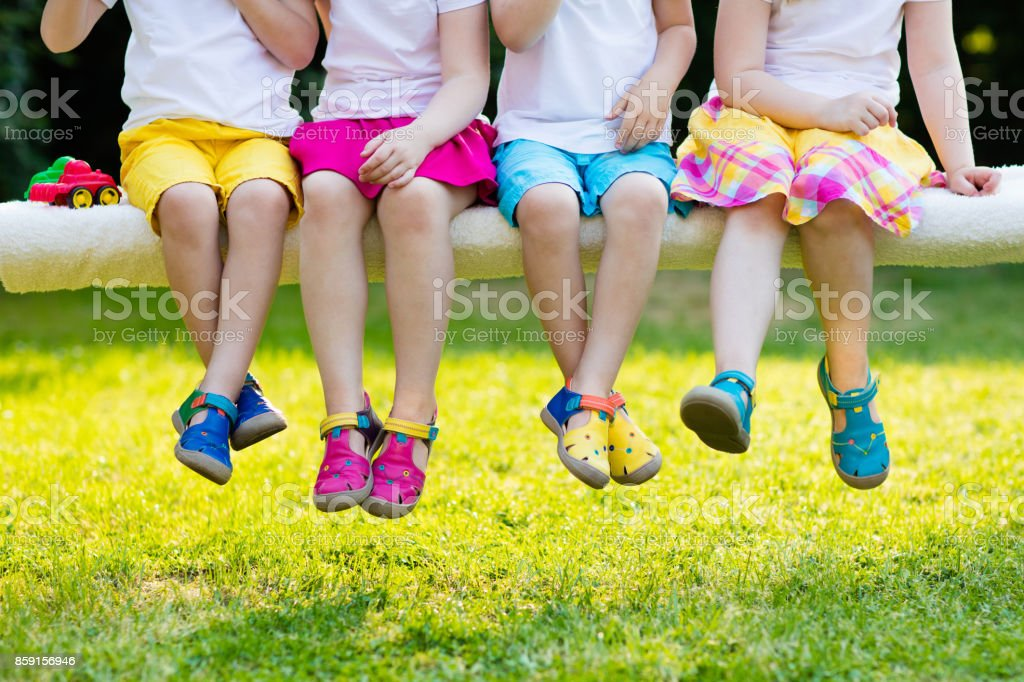 Kids with colorful shoes. Children footwear stock photo