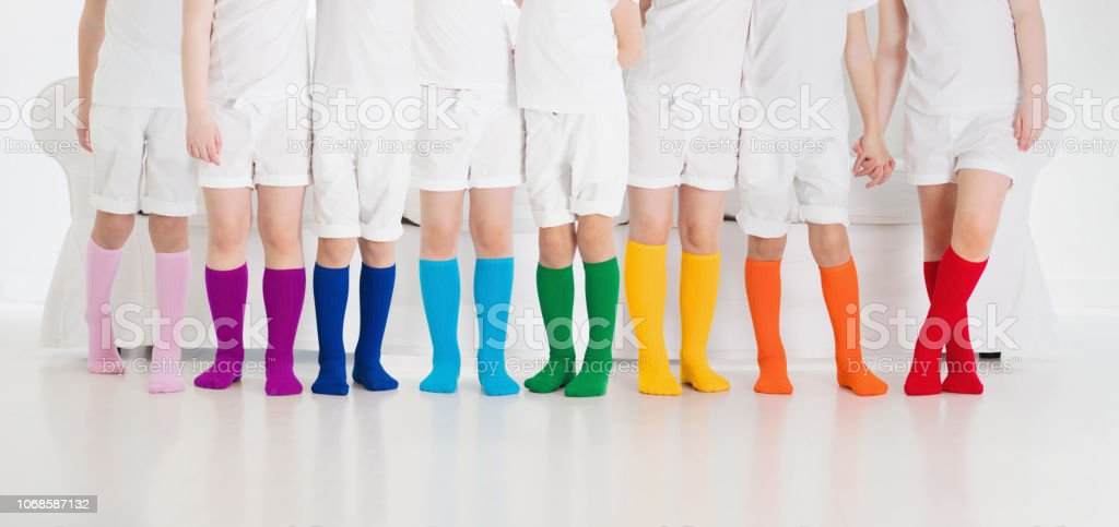 Kids with colorful socks. Children footwear. stock photo