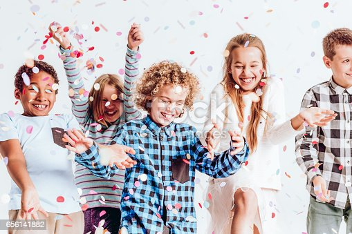 istock Kids with confetti 656141882