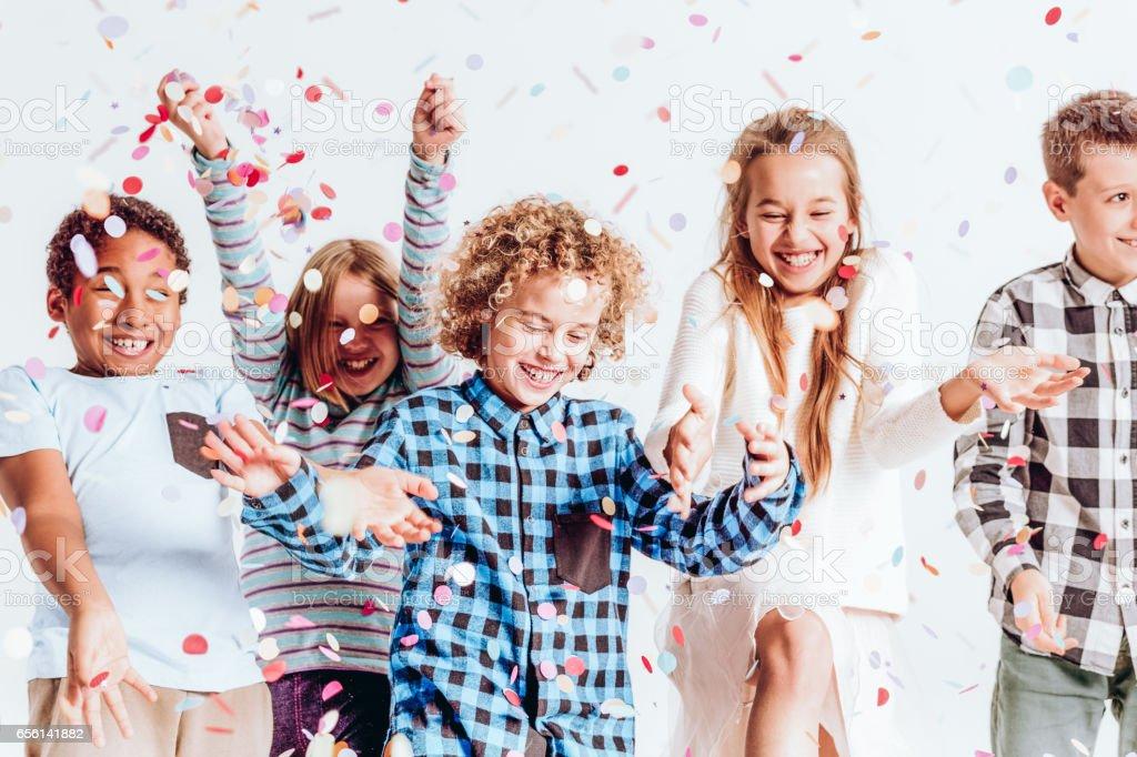 Kids with confetti stock photo