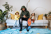 istock Kids with father playing fishing at home 1224783016