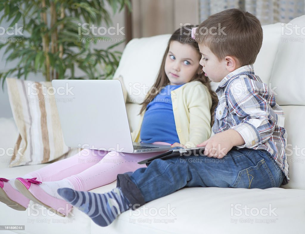 Kids with gadgets. royalty-free stock photo