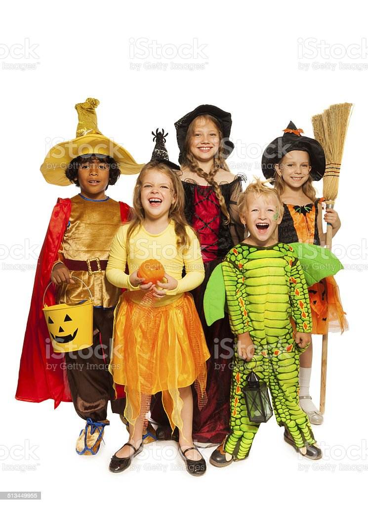Kids with Halloween attributes in stage costumes stock photo