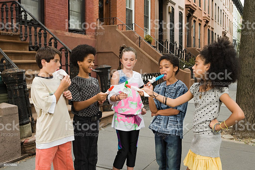 Kids with ice lollies royalty-free stock photo