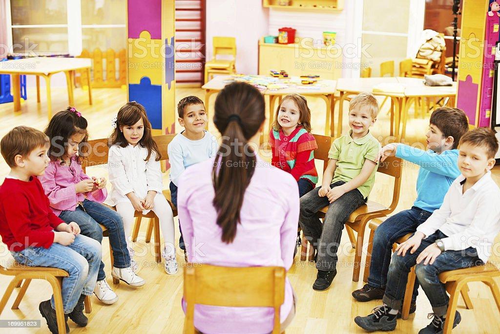 Kids with kindergarten teacher. royalty-free stock photo