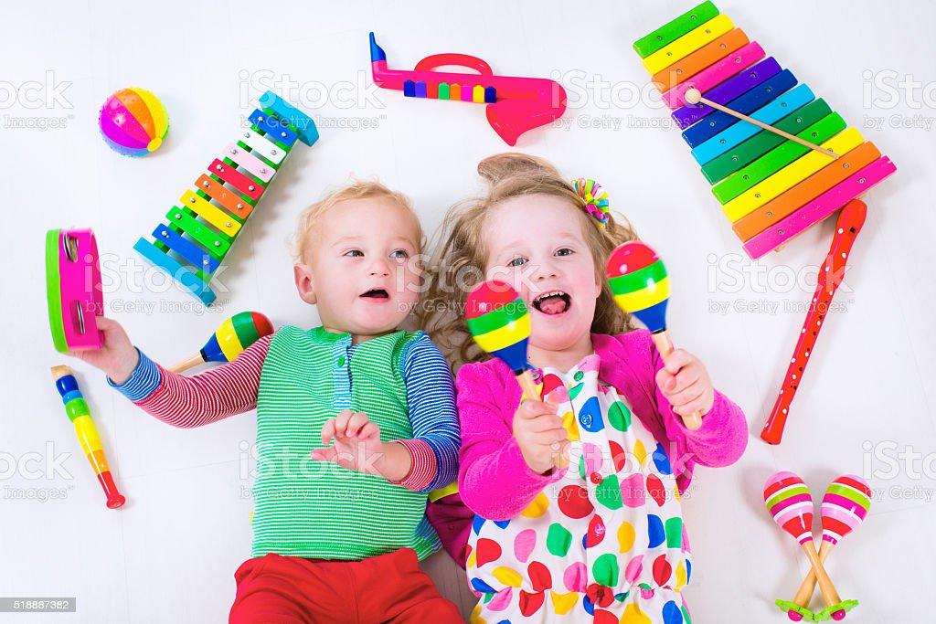 Kids with music instruments. stock photo