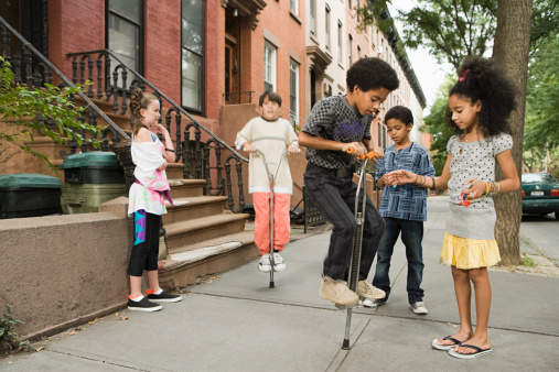 Kids With Pogo Sticks Stock Photo - Download Image Now