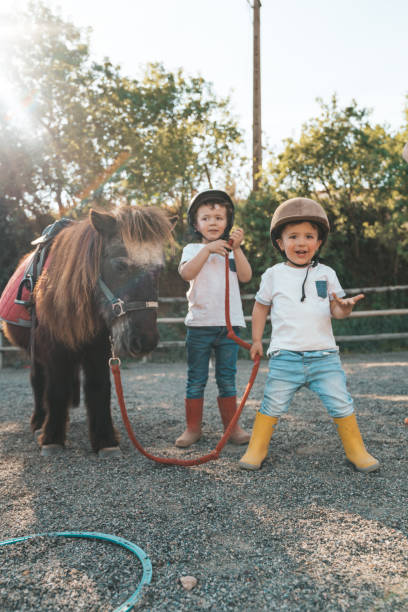 Kids with pony Kids with pony pony stock pictures, royalty-free photos & images