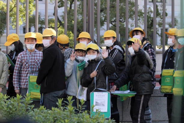 Kids with protecting masks in Tokyo, Japan stock photo